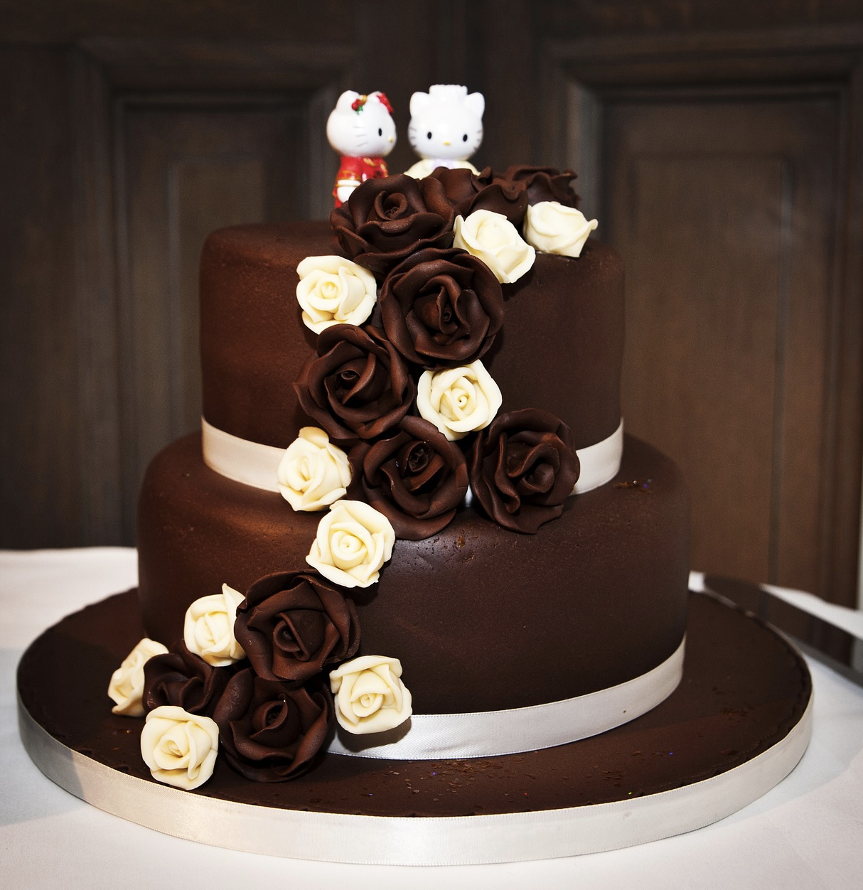 3 layer chocolate wedding cake with couple hello kitty character on the top