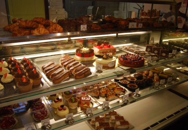 baked goods inside the glass stand