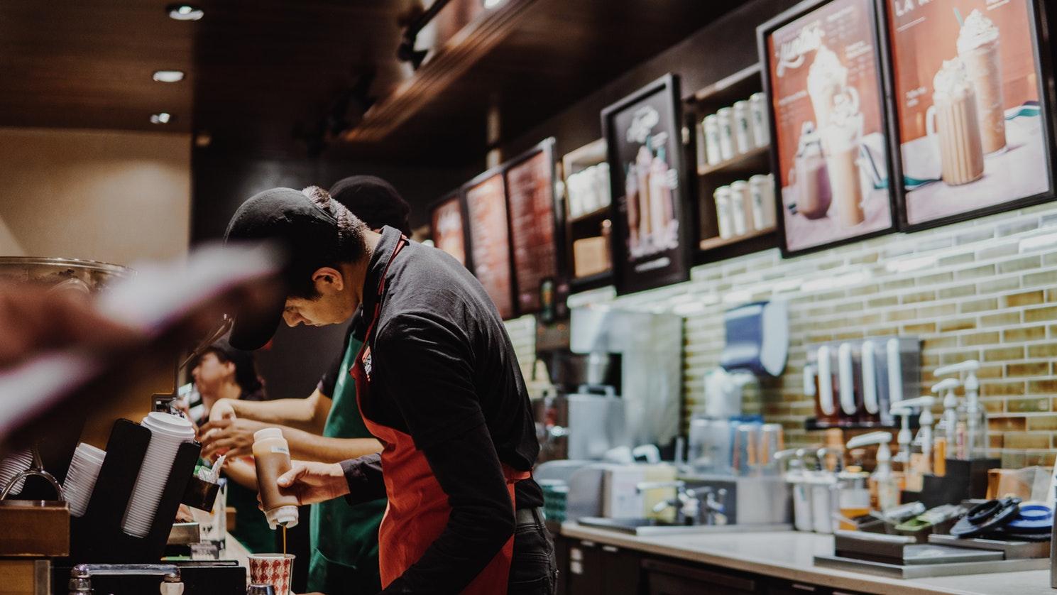 man preparing Starbucks Smoothies