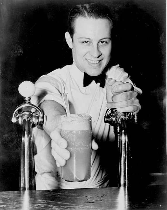 bartender offering a glass of milkshake