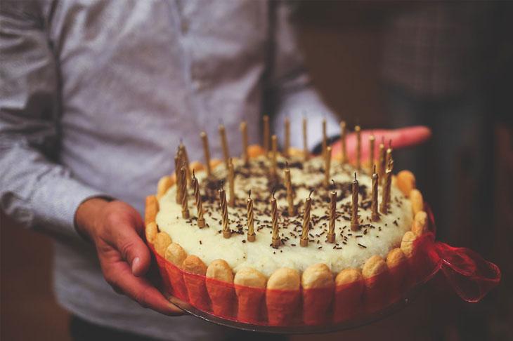 birthday cake in men hands