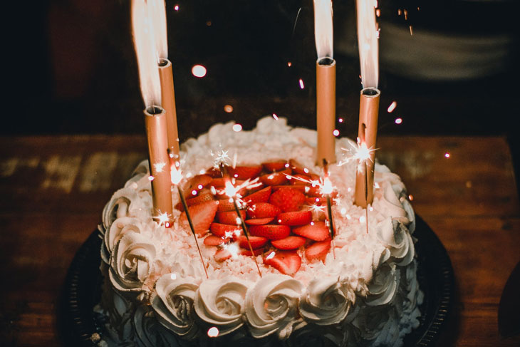 lighted candles on white icing